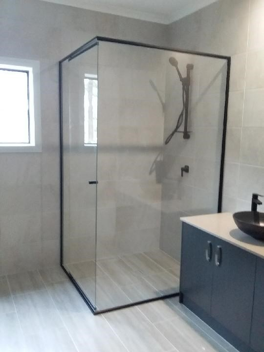 Shower screen installed in a bathroom located in the corner