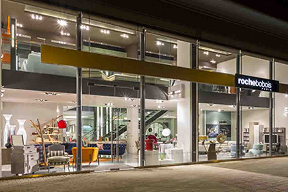 Exterior view of a Roche Bobois showroom with glass shopfront