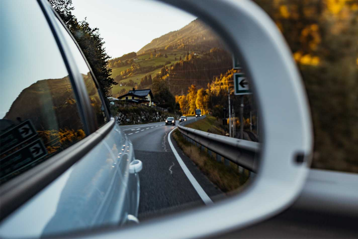 Beautiful landscape view through side view mirror of a car