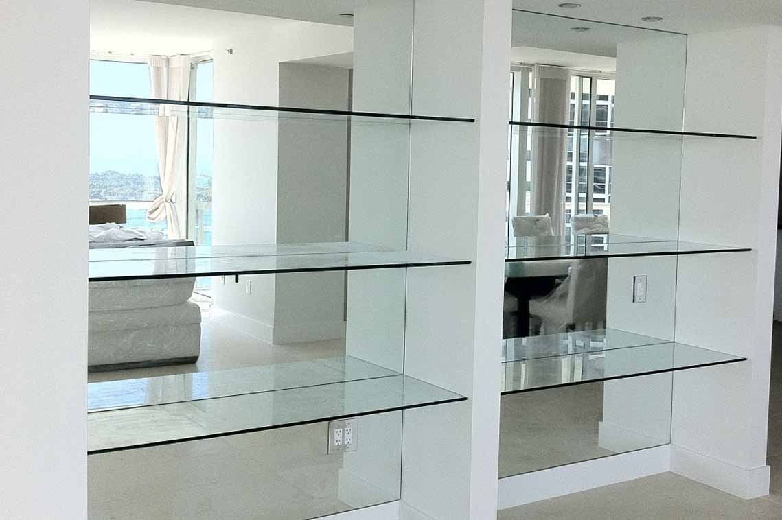 White wooden cupboard with glass shelves