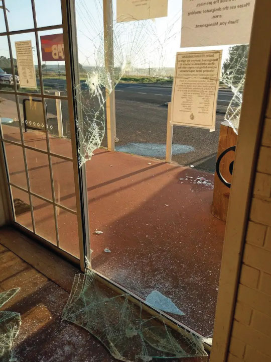 Completely smashed glass door