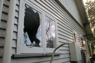 Exterior view of a house with broken window