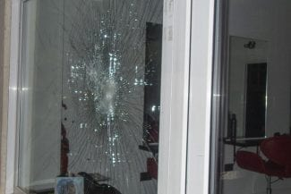 Close up image of broken glass window
