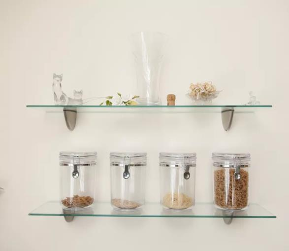 Food jars and showpiece kept on glass shelves