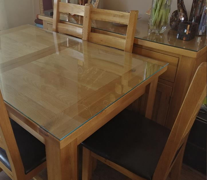 Brown dinning table with glass table top
